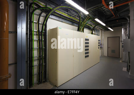 Cabling to electrical control boxes in plant room. - Stock Image
