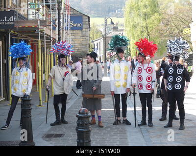 Young performers in traditional costume perform the Midgley Pace Egg Play at Hebden Bridge, a traditional mumming play in the Calder Valley - Stock Image