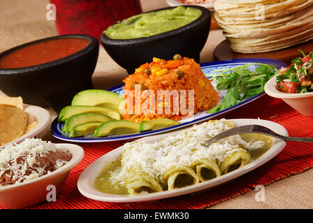 Stock image of traditional mexican green enchilada dinner - Stock Image