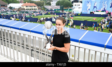 Eastbourne, UK. 24th June, 2019. Ashleigh Barty from Australia proudly holds the WTA World No 1 trophy at the Nature Valley International tennis tournament held at Devonshire Park in Eastbourne . Credit: Simon Dack/Alamy Live News - Stock Image