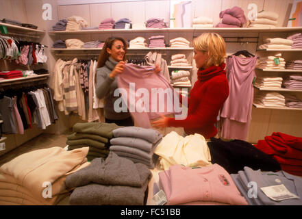Women shopping together in clothing store in Stockholm - Stock Image