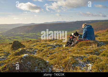 Anthills with a Walker Resting with her Dog on the Black Mountains - Stock Image