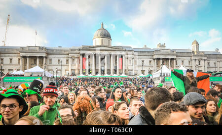 London, UK. 17th Mar, 2019.  Following the spectacular St Patrick's Day Parade earlier, people celebrate and watch performances on Trafalgar Square in the heart of London. Credit: Imageplotter/Alamy Live News - Stock Image
