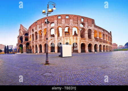 Colosseum square panoramic dawn view in Rome, famous landmarks of capital of Italy - Stock Image