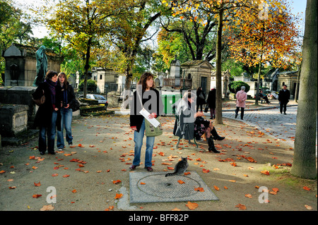 Paris, France - 'Pere Lachaise Cemetery', Group Teen Tourists Visiting Urban Park in Autumn - Stock Image