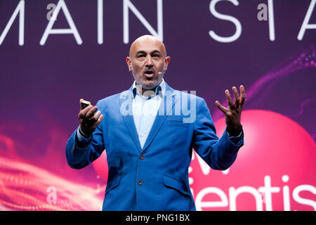 Physicist and broadcaster, Jim Al-Khalili, giving a bief history of Gravity, how it shapes the Cosmos but how we dont completely understand it. on the main Stage, at New Scientist Live - Stock Image