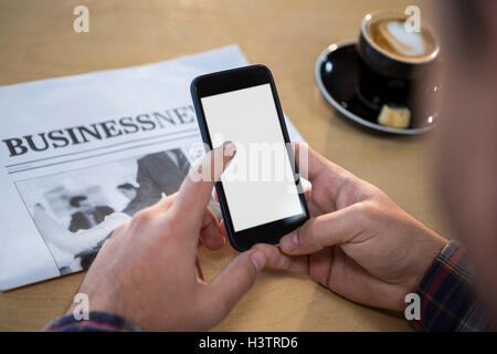 Hands of a man using mobile phone - Stock Image