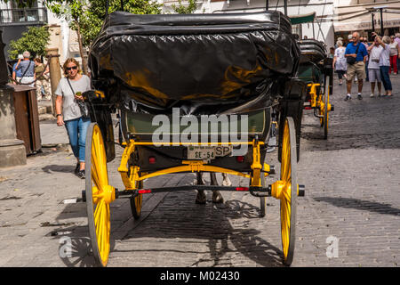 Stock photo ID: 773648392  SEVILLE, ANDALUSIA / SPAIN - OCTOBER 13 2017: OLD YELLOW CART WHEEL - Stock Image