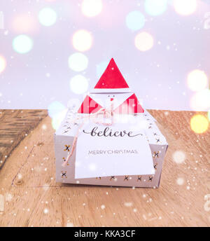 Christmas Decoration with Gifts and Lights under colorful bokeh for best background image for Holiday invitation - Stock Image