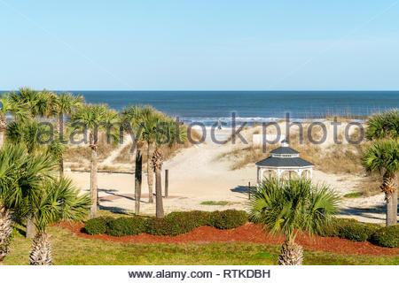 A couple walks along the beach at St Augustine Beach, Florida, USA - Stock Image