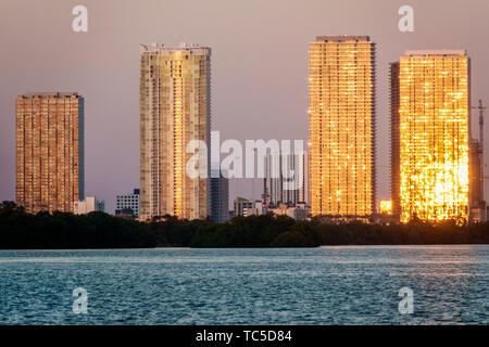 Miami Florida Edgewater Biscayne Bay high rise luxury residential condominium buildings sunrise reflected sunlight golden - Stock Image
