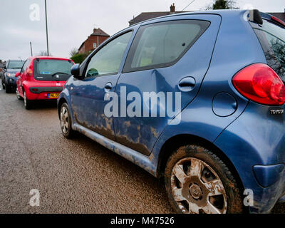 Ashbourne, UK. 14th February, 2018. Cars damaged by the scrum during Ashbourne Royal Shrovetide hugball Football - Stock Image