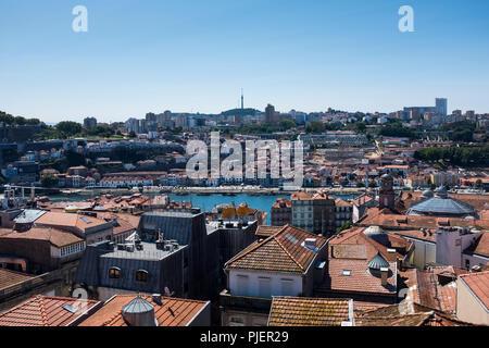 View over the rooftops towards Vila Nova de Gaia, Porto, Portugal. - Stock Image
