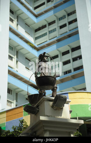 Statue honouring early Chinese traders and merchants in Smith Street, Chinatown, Singapore - Stock Image
