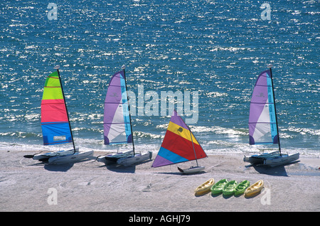 Marco Island FL Florida Southwest Florida Naples area sailboats and kayaks on beach - Stock Image