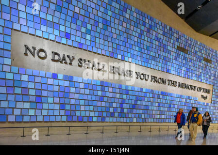 Inside of the National September 11 (9/11) Memorial and Museum. Entrance detail. Blue wall with text reading: No Day Shall Erase You From the Memory o - Stock Image