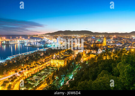Malaga Old Town Cathedral and Port Harbour Harbor scenic view at sunset twilight dusk evening Malaga Spain. From - Stock Image