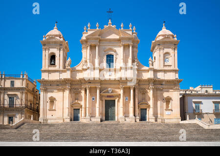 Front elevation and steps of Baroque Cathedral of Saint Nicholas - Basilica di San Nicolo in Noto city, Sicily, Italy - Stock Image