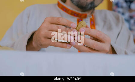 Potter making clay figure for board game - Stock Image