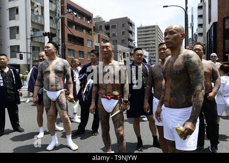 TOKYO, JAPAN - MAY 18: Heavily tattooed Japanese men wait for miyoshi n the street of Asakusa during 'Sanja Matsuri' on May 18, 2019 in Tokyo, Japan. A boisterous traditional mikoshi (portable shrine) is carried in the streets of Asakusa to bring goodluck, blessings and prosperity to the area and its inhabitants. (Photo: Richard Atrero de Guzman/ AFLO) - Stock Image