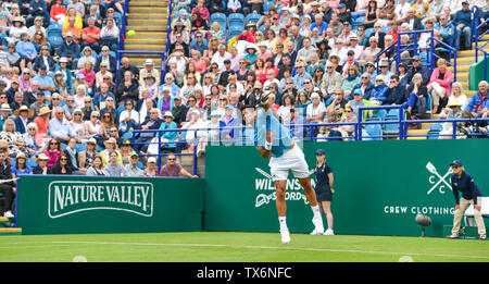 Eastbourne, UK. 24th June, 2019. Fernando Verdasco of Spain serves against John Millman of Australia during their match at the Nature Valley International tennis tournament held at Devonshire Park in Eastbourne . Credit: Simon Dack/Alamy Live News - Stock Image