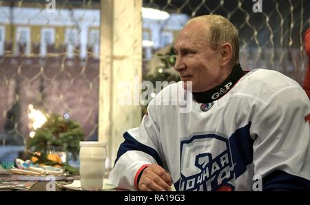 Moscow, Russia. 29th December 2018. Russian President Vladimir Putin following the Night Hockey League match in the rink at the GUM Department store in Red Square December 29, 2018 in Moscow, Russia. Credit: Planetpix/Alamy Live News - Stock Image
