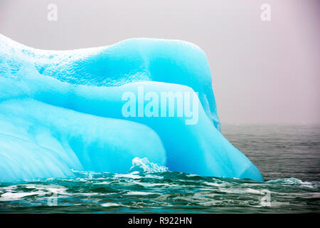 An iceberg from a glacier in northern Svalbard. All of Svalbards glaciers are retreating, even in the north of the archiapelago despite only being around 600 miles from the North Pole. - Stock Image