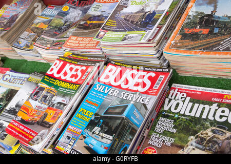 Stacks of bus enthusiast and steam train heritage magazine back numbers, for sale on a stall at a steam railway - Stock Image