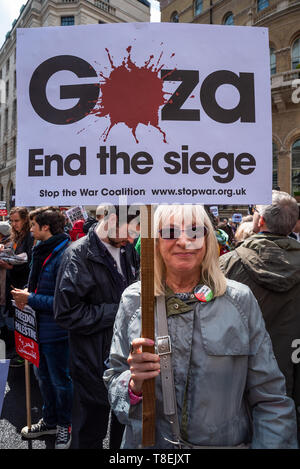 London, UK. May 11th 2019. National Demonstration for Palestine. Thousands of activists marched from Portland Place to Whitehall. Organised by the Palestine Solidarity Campaign, Stop the War Coalition, Palestinian Forum in Britain, Friends of Al- Aqsa & Muslim Association of Britain. Pictured, activist holding Gaza, End the Siege placard. Credit: Stephen Bell/Alamy Stock Photo - Stock Image