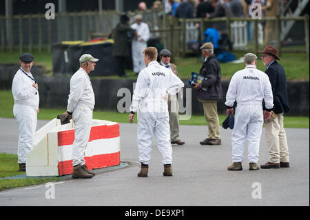 Chichester, West Sussex, UK. 13th Sep, 2013. Goodwood Revival. Goodwood Racing Circuit, West Sussex - Friday 13th September. Marshalls inspect the track at the chicane. © MeonStock/Alamy Live News - Stock Image