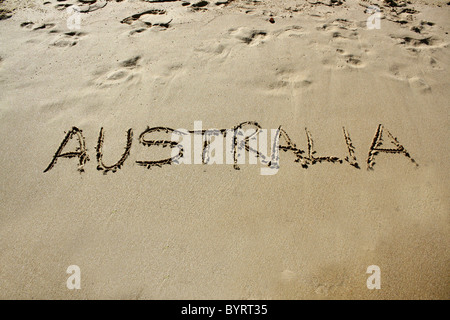 'Australia' written out in wet sand. Please see my collection for more similar photos. - Stock Image