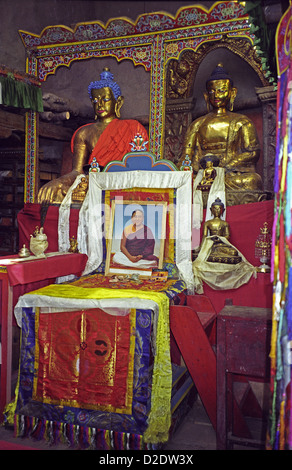Buddha statues offerings and paintings inside Sakya Gompa temple at Jharkot on Annapurna circuit Nepal Himalayas - Stock Image