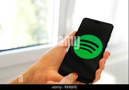 Spotify music app symbol hand smartphone - Stock Image