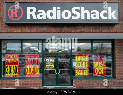 "Waltham, Massachusetts, USA. 10th Feb, 2015. Small RadioShack retail store advertises a ""Going Out of Business"" - Stock Image"