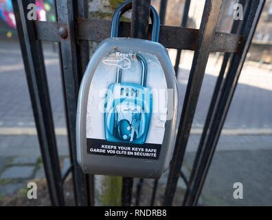 Key safe box illegally attached to railing used to store keys for AirbnB short term let tenants in Edinburgh, Scotland, UK - Stock Image