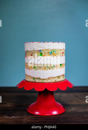 Simple Funfetti Cake with Space Above over rustic wooden table - Stock Image