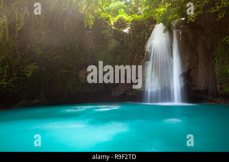 Incredible turquoise-colored Kawasan waterfalls located on Cebu Island, Philippines - Stock Image