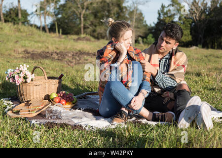 man and woman with scarves, under the sun of a cold day - Stock Image