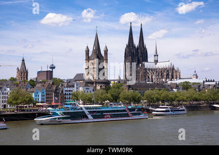 the river Rhine, the old part of the town with the steeple of the historic town hall, the romanesque church Gross St. Martin and the gothic cathedral, - Stock Image