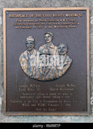 GREENSBORO, NC, USA-2/14/19: Plaque in front of Greensboro Woolworth, , documenting the first 'sit-in'  beginning  the `1960s  civil rights movement. - Stock Image