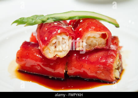 Shrimp filled crispy red rice flour rolls served at Shang Palace Shangri-La Hotel Paris - Stock Image