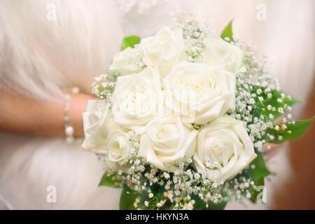 bride holding her wedding bouquet - Stock Image