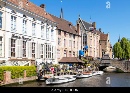 Boat tours from the landing stage on The Den Dijver canal in front of the Hotel De Orangerie a 15th-century former convent in Bruges Belgium EU Europe - Stock Image