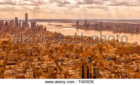 New York city, USA, urban skyline in a golden color filter. The area is a famous place and tourist attraction - Stock Image