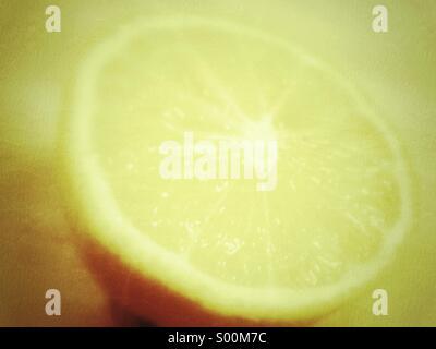 Soft focus close up of sliced lemon. - Stock Image