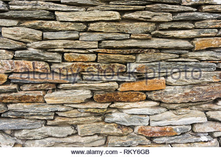 Wall background made of rough stone plates. - Stock Image