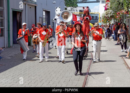Vancouver, Canada.1st July, 2018. A marching band  leads the annual Canada Day Parade on Granville Island, Vancouver, British Columbia. This year Canada Day celebrates the country's 151st birthday. Credit: John Mitchell/Alamy Live News - Stock Image