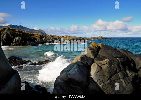 Rock formations on the shore of the North Atlantic near Hov on island Gimsøy on Lofoten in northern Norway. - Stock Image