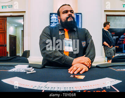 Rio de Janeiro, Brazil - March 21st, 2019: Close up of poker dealer at the the Main Event of the PartyPoker LIVE MILLIONS South America 2019 occuring at the luxurious Copacabana Palace Belmond Hotel in Rio de Janeiro, Brazil from March 15th through March 24th, 2019. Credit: Alexandre Rotenberg/Alamy Live News - Stock Image