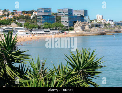 High perspective of crowded sandy beach in Cascais near Lisbon, Portugal in the Costa Verde. This beach is known as Praia da Conceicao - Stock Image